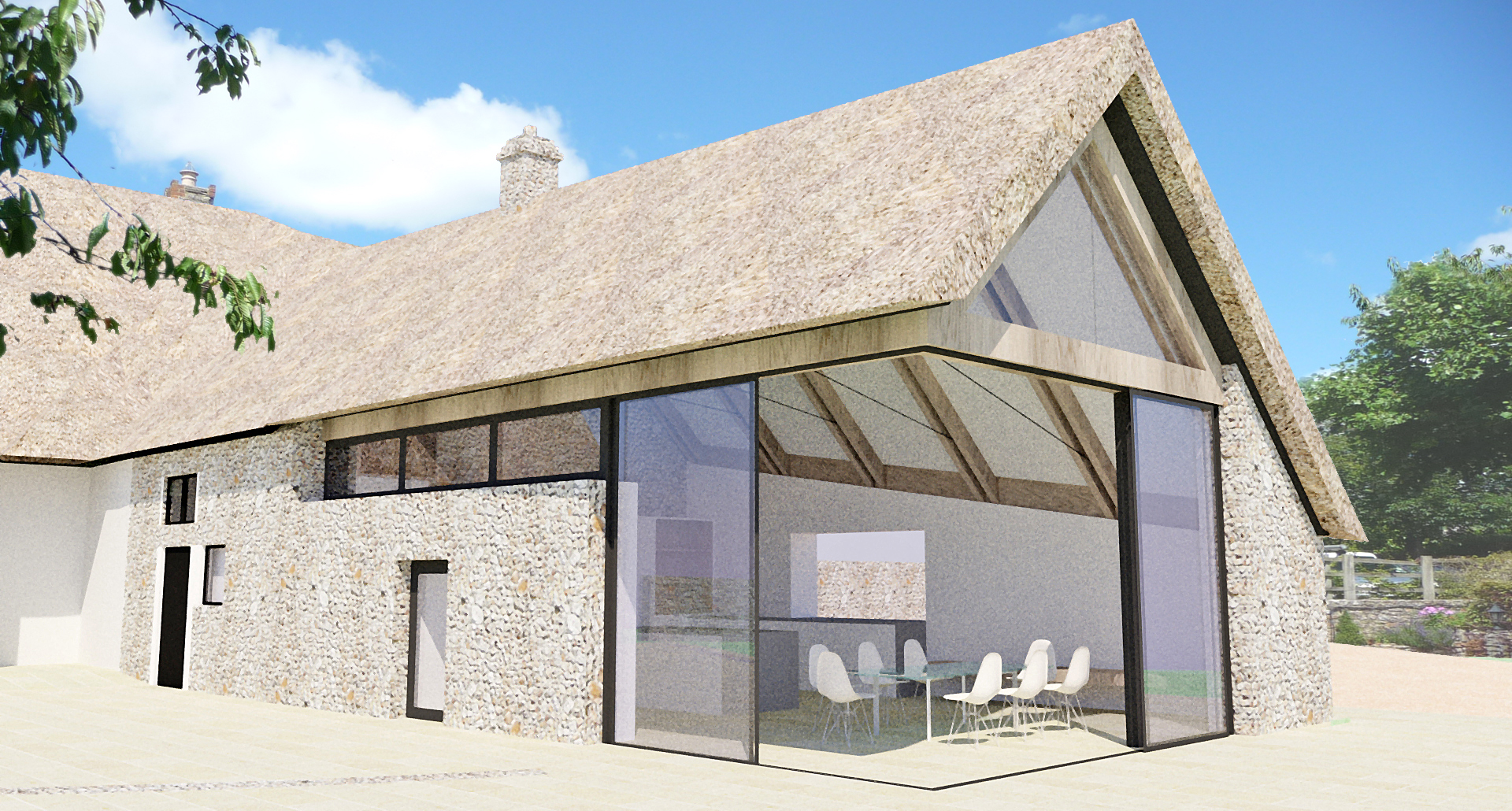 A contemporay thatched roof extension to a listed